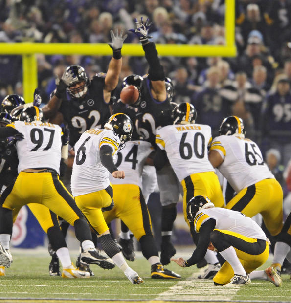 Shaun Suisham kicks the game-winning field goal against the Ravens.