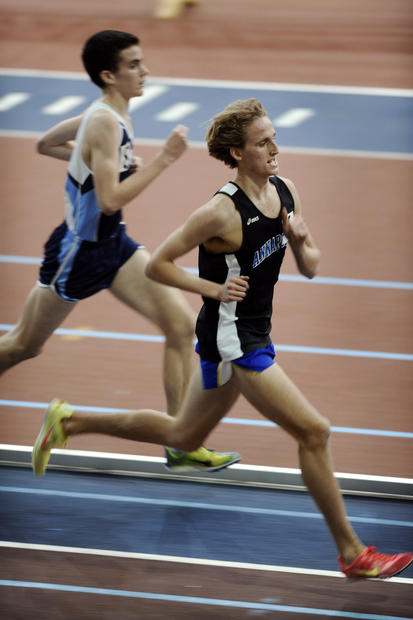 Annapolis' Hale Bullen, right, laps another runner to easily win the boys' 3,200-meter race during the Anne Arundel County indoor track championship.