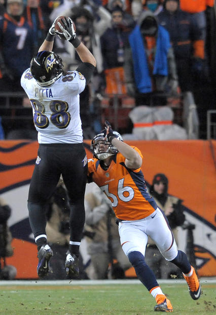 Ravens tight end Dennis Pitta, left, makes a catch over the Denver Broncos safety Jim Leonhard in the fourth quarter.