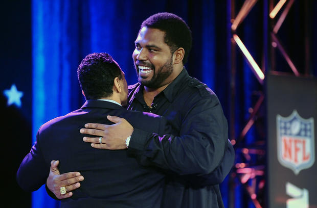 Jonathan Ogden is greeted by former teammate and Hall of Famer Rod Woodson after being voted into the Hall on Saturday evening in New Orleans.