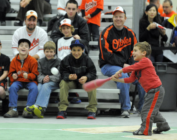 Nathaniel Wolf, 3, of Owings, hits a wiffle ball during FanFest.