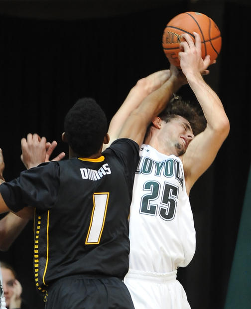 Towson's Marcus Damas is called for a foul against Loyola's Robert Olson.