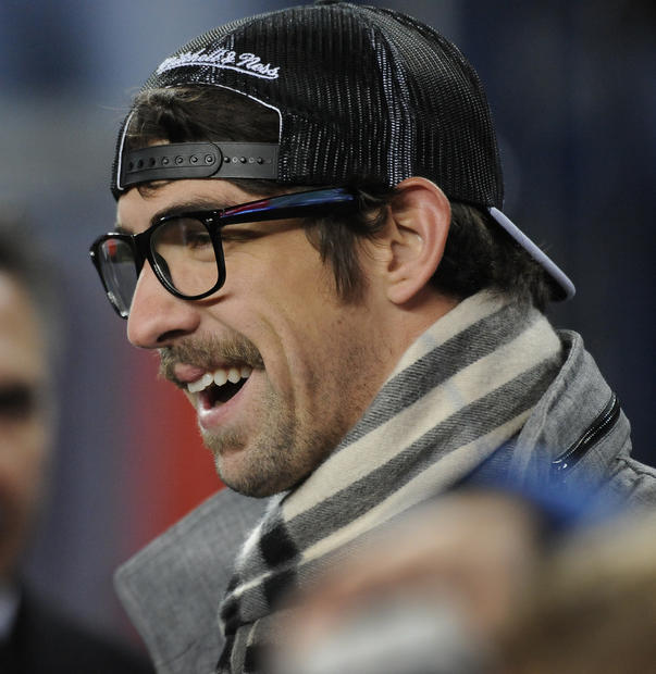 Michael Phelps claimed a spot on the sideline for the Ravens-Patriots AFC championship game.