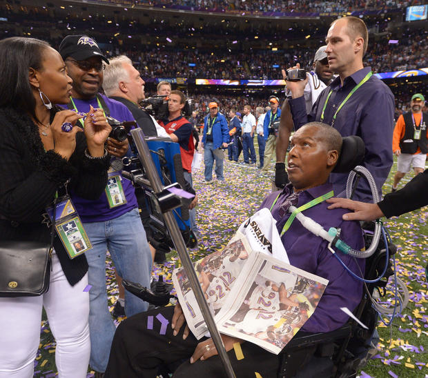 O.J. Brigance celebrates the Ravens' Super Bowl win.