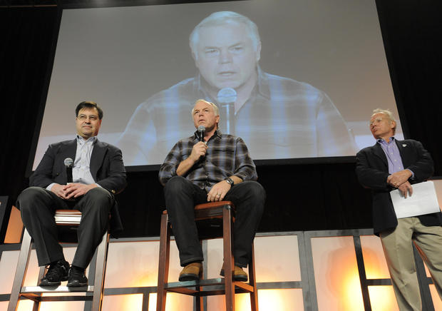 Orioles manager Buck Showalter, center, speaks during FanFest as general manager Dan Duquette, left, and broadcaster Gary Thorne, right, listen.