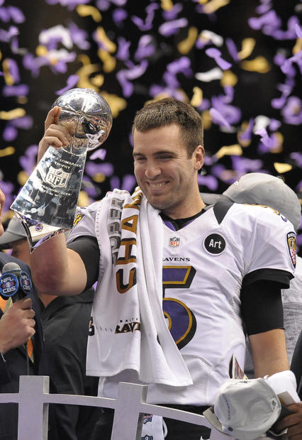 Joe Flacco holds up the Lombardi Trophy.