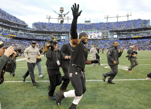 Ray Lewis takes a victory lap after the Ravens' win over the Colts.