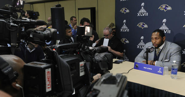 Ravens linebacker Ray Lewis answers questions from the media after the team arrived in New Orleans for Super Bowl XLVII.