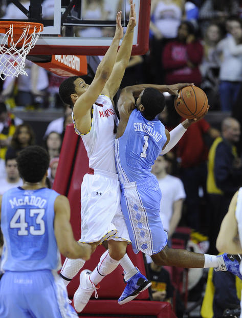 Seth Allen tries to block the shot of North Carolina's Dexter Strickland.