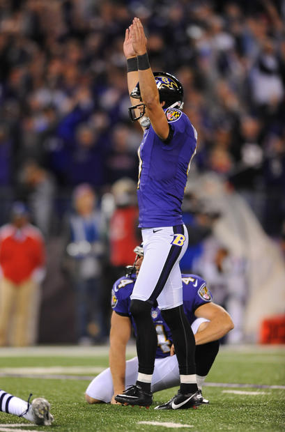Justin Tucker celebrates his game-winning 27-yard field goal against the Patriots.