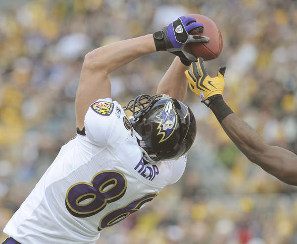 Ravens tight end Todd Heap leaps to haul in this first-quarter touchdown reception. Heap caught two touchdowns in the Ravens' 23-20 loss to the Pittsburgh Steelers.