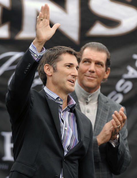 Ravens owner Steve Bisciotti claps in the background as Matt Stover is inducted into the team's Ring of Honor.