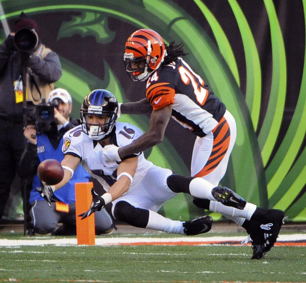 David Reed can't catch the ball as he is defended by Bengals defensive back Adam Jones.