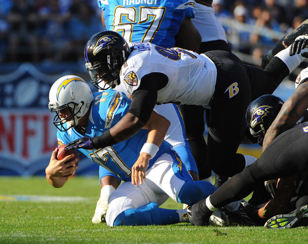 Courtney Upshaw sacks Chargers QB Philip Rivers.