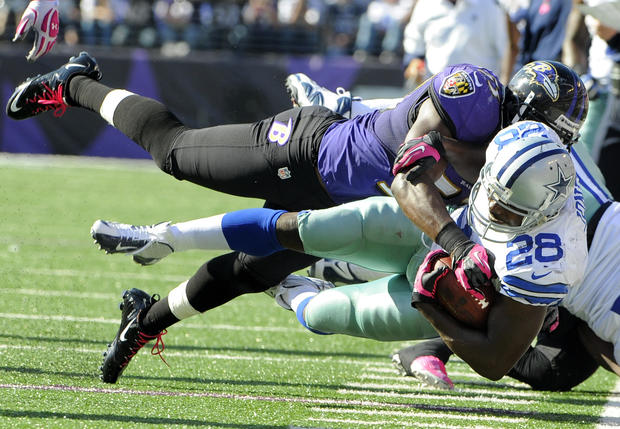 Jameel McClain tackles Dallas' Felix Jones in the third quarter.