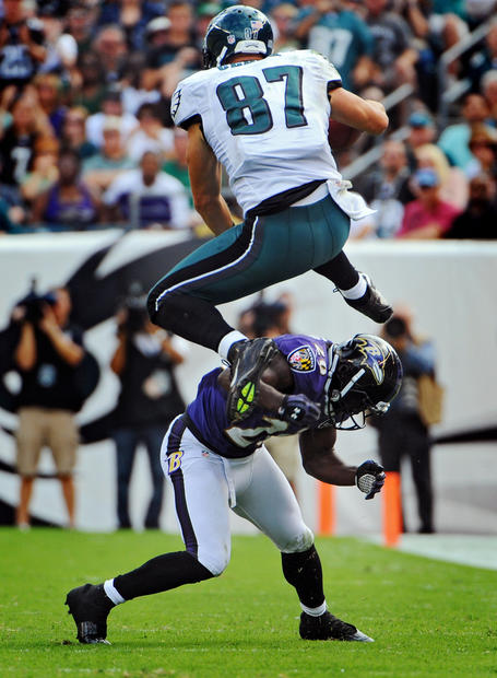 Eagles tight end Brent Celek jumps over Ravens safety Ed Reed after a third-quarter reception.