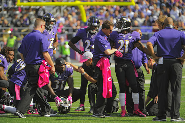 Lardarius Webb looks back at his teammates as he's helped off the field in the first quarter. He suffered an apparent ACL injury.