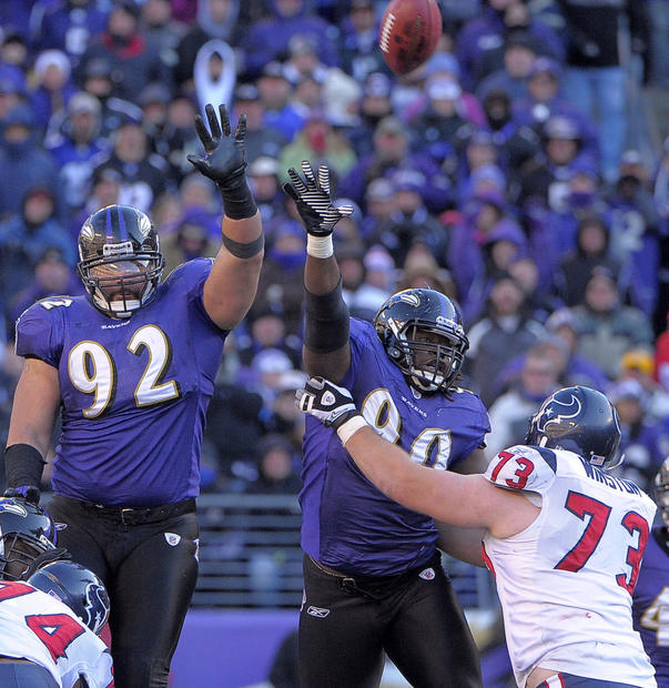 Haloti Ngata and Pernell McPhee jump to try and block a field-goal attempt by Houston's Neil Rackers. His kick felt short.