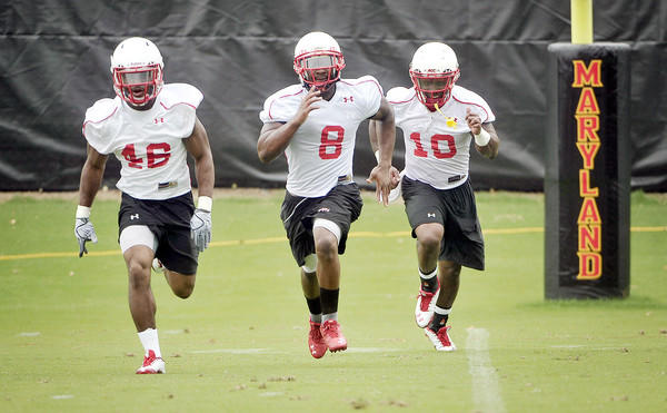 From left, Terps running backs Kwabena Ofori, Davin Meggett and D.J. Adams take part in Maryland's first practice.