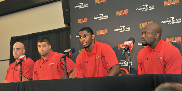 The Terps captains -- Andrew Gonnella, Joe Vellano, Kenny Tate and Davin Meggett -- face reporters during the team's media day.