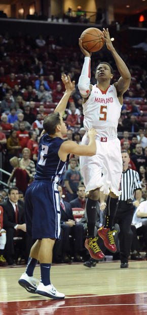 Maryland's Nick Faust shoots over Monmouth's Jesse Steele in the second half. Faust led the Terps with 16 points.