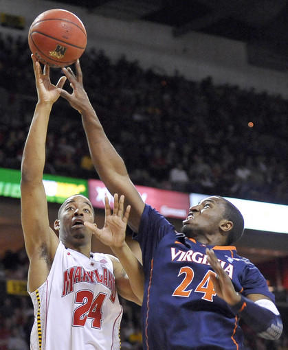 Maryland Terrapins guard/forward Cliff Tucker (left) is fouled by Virginia Cavaliers guard K.T. Harrell while shooting, but is unable to make the shot count in the second half