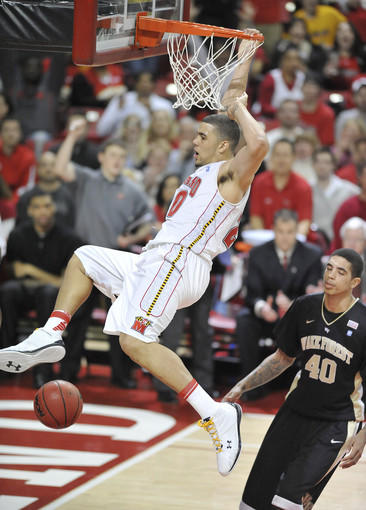 Maryland's Jordan Williams slams the ball in front of Wake Forest's Ty Walker. Williams tied a career high with 27 points and added 15 rebounds.