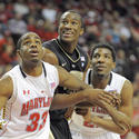 Maryland's Dino Gregory and Pe'Shon Howard box out Wake Forest's Travis McKie in the first half of the Terps' 91-70 win.