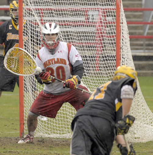 Maryland goalie Brian Phipps blocks a shot by Towson midfielder Will Harrington in the third quarter.