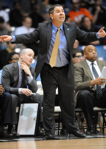 Towson men's basketball coach Pat Skerry shouts instructions during the game against Northeastern.
