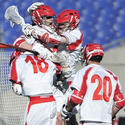 Cornell players players celebrating late tying goal at Face-Off Classic