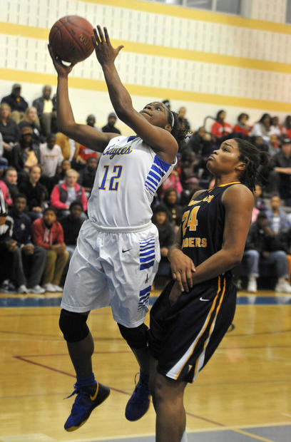 Aberdeen guard Jimmia McCluskey, left, scores in front of Riverdale Baptist's Maya Singleton.