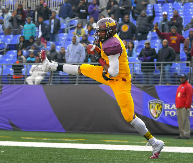 Dunbar wide receiver Wilbur Young hauls in a touchdown reception against New Town in the Class 1A football state championship at M&T Bank Stadium.