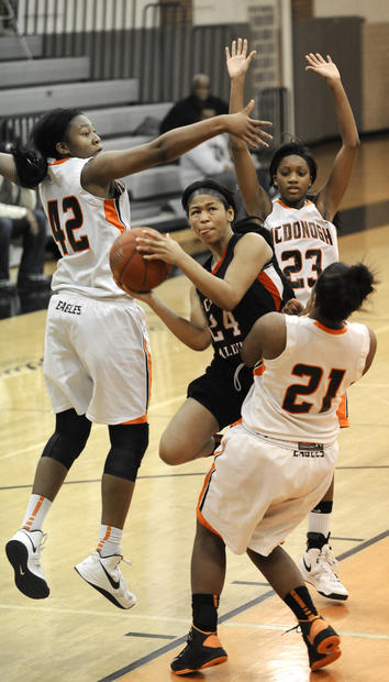 Archbishop Spalding's Aleah Epps drives through McDonogh defenders Jameira Johnson, left, Brianna Jacobs, front, and Maya Wynn in the third quarter.