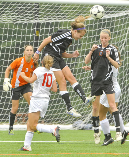 McDonogh's Liz Bannatine, center, heads the ball away while Ashley Spivey, right, goalie Morgan Ruhl, left, and Lenape's Nicolette Stoner look on.