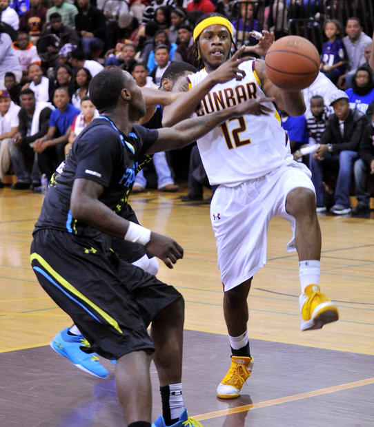 Dunbar's Donte Pretlow is fouled by Patterson's Nyme Manns in the first half.