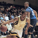 Towson's David Brewster drives to the basket