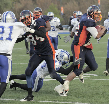 Morgan State quarterback Mario Melton (right) gets tackled by Hampton safety Jonathan Wade in the fourth quarter.