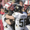 Wake Forest defenders tackle Chris Turner