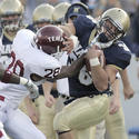 Navy's Eric Kettani tries to keep running