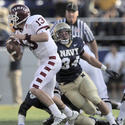 Navy linebacker Ram Vela gets a sack