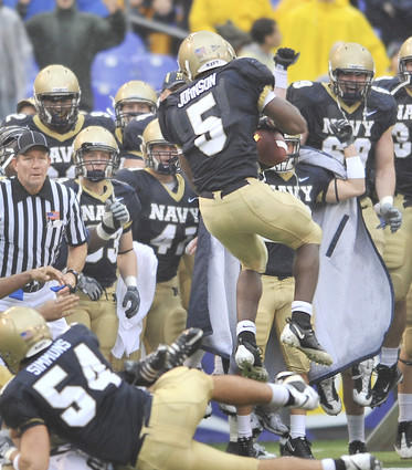 Navy's Corey Johnson (5) recovers an on-side kick after quarterback Ricky Dobbs' fourth-quarter touchdown. The Mids scored two touchdowns and recovered two straight on-side kicks late in the fourth quarter, but couldn't overtake the Fighting Irish, losing 27-21.