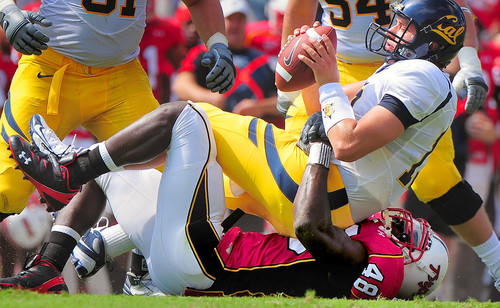 Maryland's Moises Fokou (bottom) sacks California quarterback Kevin Riley during the Terps' 35-27 upset win over No. 23 California in College Park.