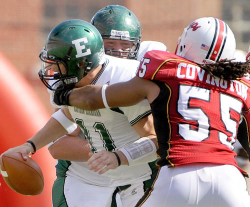 Terps linebacker Trey Covington (right) wraps up Eastern Michigan quarterback Kyle McMahon for a sack in the second half. The Terps cruised to a 51-24 victory over Eastern Michigan.