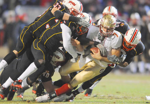 Florida State quarterback Christian Ponder (7) is tackled by a group of Terps defenders, including linebacker Alex Wujciak (33) and defensive lineman Jeremy Navarre (40), in the first quarter at Byrd Stadium.
