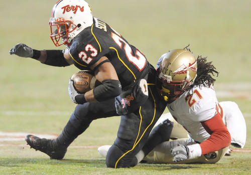 Terps running back Da'Rel Scott is pulled down after a reception by Florida State cornerback Patrick Robinson in the second half.