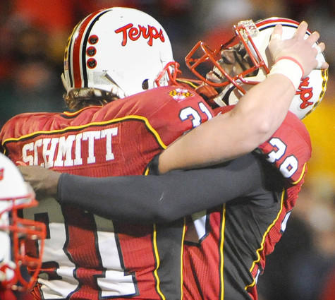 Maryland kicker Obi Egekeze (right) celebrates with long snapper Andrew Schmitt after hitting the game-winning 26-yard field goal with 1:42 remaining.