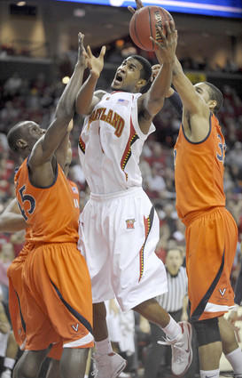 Landon Milbourne splits Virginia defenders Solomon Tat (45) and Mike Scott (32) to score two of his 17 points.