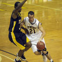 UMBC's Matt Spadafora dribbles around Toledo's Tyrone Kent