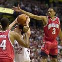 Juan Dixon and Terence Morris defend against Ryan Mendez
